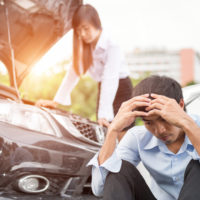 man-upset-due-to-car-accident