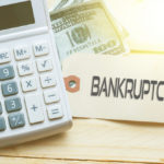 Calculator and bankruptcy sign