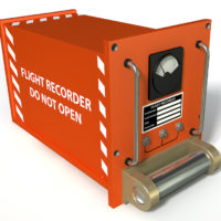 Red airplane black box that say flight recorder do not open