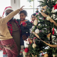 A black family enjoying Christmas holiday together