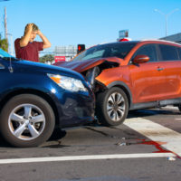 Serious car wreck at intersection due to wrong-way driving