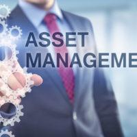 Businessman points at Asset Management caption