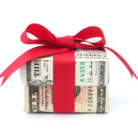 Dollar wrapped gift box with a red ribbon bow