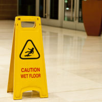 Caution Wet Floor signage in lobby