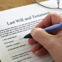 Man filling out his Will form.jpg.crdownload
