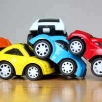 colorful miniature cars show multiple chain reaction car accident