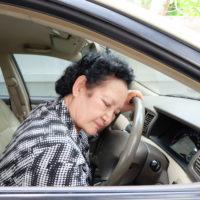 senior-woman-alseep-behind-the-wheel