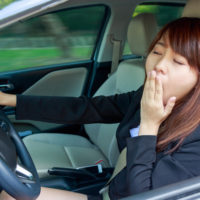 Girl yawning while driving