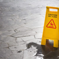 slip and fall sign next to wet floor