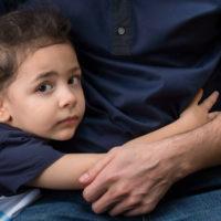 Young boy hugging his dad