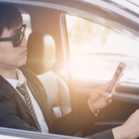 A business man on phone while driving