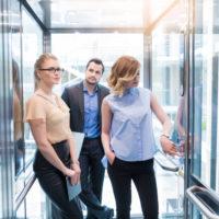 employees inside an Elevator