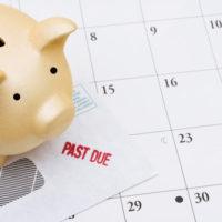 piggy bank sitting on a calendar