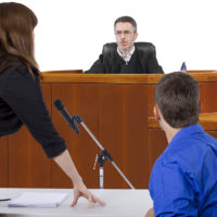divorce lawyer talking with judge during Courtroom Trial