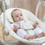 infant in swing