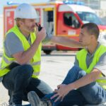 manager calling for help for construction worker injured at work