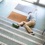 Unconscious Man Lying On Staircase