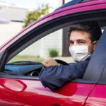 Young driver with face mask