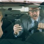 accident in car . man and woman using cellphone while driving car